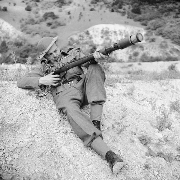 A_member_of_the_Home_Guard_demonstrates_a_rifle_equipped_to_fire_an_anti-tank_grenade,_Dorking,_3_August_1942._H22061