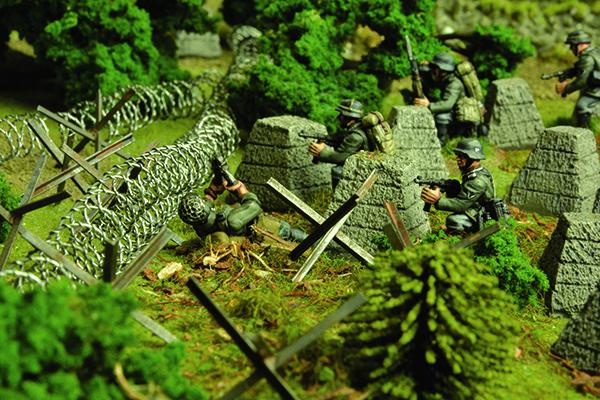 German Pioniers make short work of the hastily erected British defences