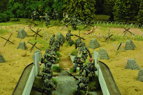 Raus! Raus! German grenadiers pile out of their landing barges and onto English sand