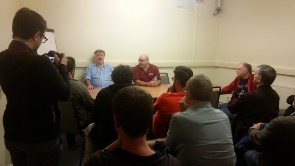 John Stallard and Paul Sawyer address a packed seminar room about Cruel Seas.