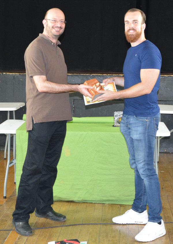 Jan Drescher receives his third place trophy.