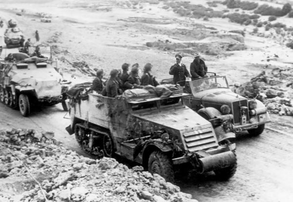 Rommel addresses his troops riding in a captured US M3 half-track.