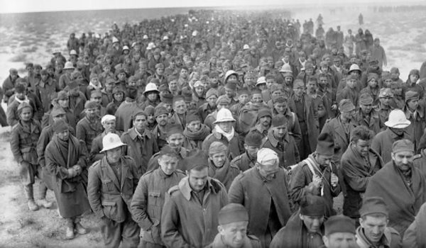 Italian prisoners marching into captivity following their defeat at Beda Fomm. Babini Group