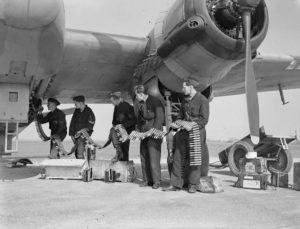 Ground crew load 20mm cannon shells into a Beaufighter MkVI Night Fighter.