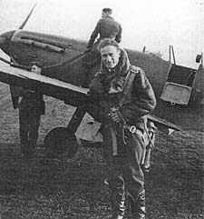 Flight Lieutenant Pat Gifford from 603 Squadron next to his Spitfire 'Stickleback' after the Forth Bridge Raid
