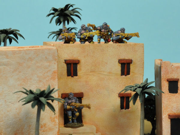Boromites atop a building, ready to use reactions on opposing troops