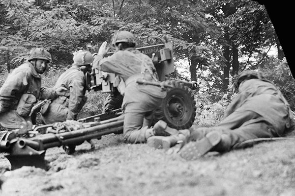'Gallipoli II', a 6-pdr anti-tank gun of No. 26 Anti-Tank Platoon, 1st Border Regiment, 1st Airborne Division, in action in Oosterbeek, 20 September 1944. The gun was at this moment engaging a German PzKpfw B2 (f) Flammpanzer tank of Panzer-Kompanie 224 and successfully knocked it out. BU 1109 Part of WAR OFFICE SECOND WORLD WAR OFFICIAL COLLECTION No 5 Army Film & Photographic Unit Smith (Sgt)