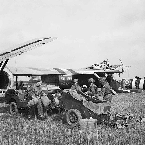 HQ of 1st Airlanding Light Regiment, Royal Artillery, unload a jeep and trailer from their Horsa glider at the landing zone near Wolfheze in Holland, 17 September 1944. Label HQ of 1st Airlanding Light Regiment, Royal Artillery, unload a jeep and trailer from their Horsa glider at the landing zone near Wolfheze in Holland, during Operation 'Market Garden', 17 September 1944. BU 1164 Part of WAR OFFICE SECOND WORLD WAR OFFICIAL COLLECTION Army Film and Photographic Unit Smith D M (Sgt)