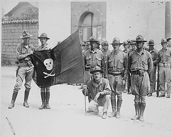US Marines with the captured flag of Nicaragua's Augusto Sandino in 1926