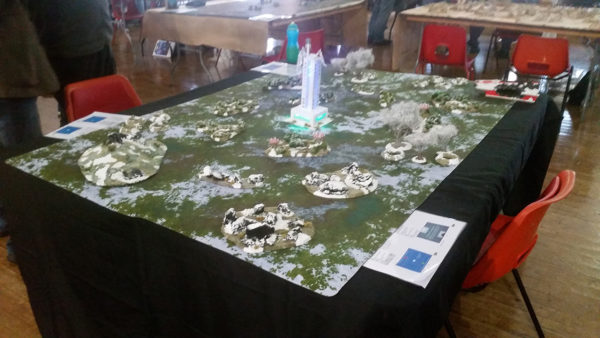 Beyond the Gates of Antares table with LED-illuminated terrain.