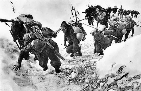 An Alpini unit struggles up a snow-covered mountainside.
