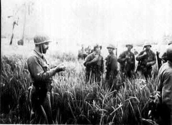 A Marine Raider officer addresses his men, somewhere in the jungles of Guadalcanal.