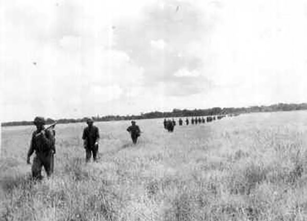 Carlson's Raiders crossing an open field on Guadalcanal. Long Patrol.