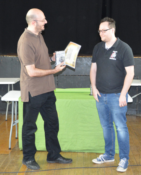 Christopher receives his award from Alessio Cavatore.