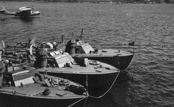 Higgins-built PT boats tied up in a harbour.