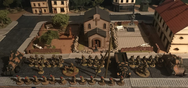 Greg's Battle of France force on parade in front of the local chapel.