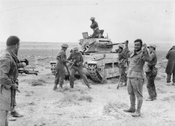 New Zealanders of the 2nd Infantry Division recapture a Matilda tank, taking the German crew prisoner in the process.