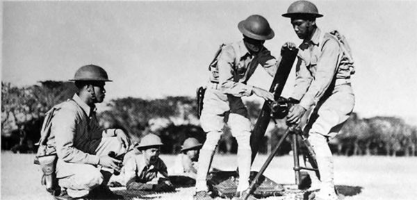 Philippine soldiers assemble a US-built medium mortar. Bataan.