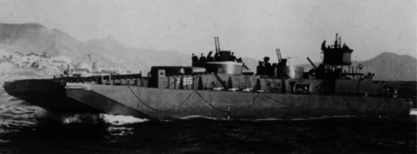 An up-armoured F-Lighter, somewhere in the Mediterranean. You can see the twin-barreled 20mm cannons amidships, with the shadow of a larger calibre gun towards the stern.