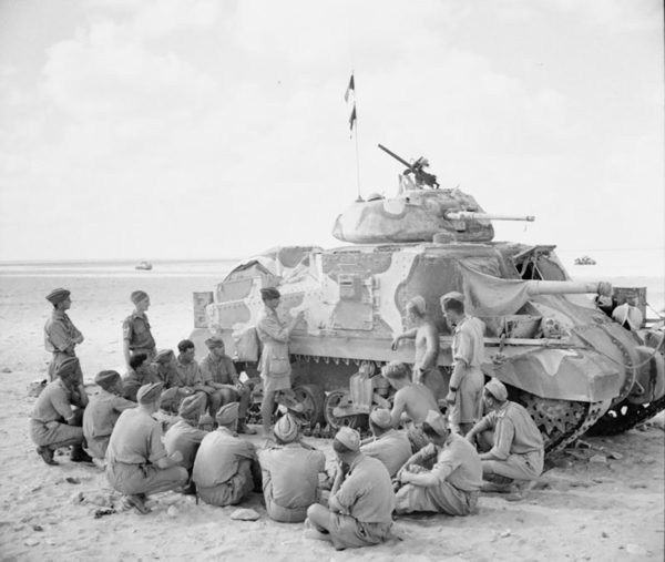 Tank crews receiving instruction on the new M3 Grant tank. This photo shows one of the camouflage patterns used by the British in the desert.
