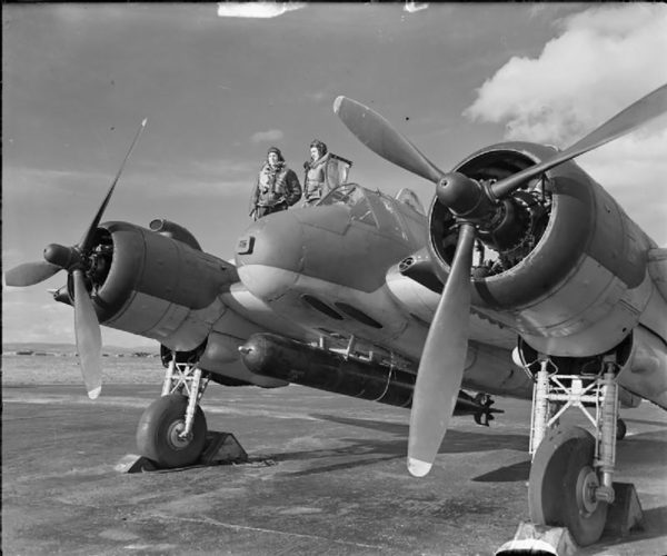 A Coastal Command Beaufighter with a torpedo loaded and ready to go.