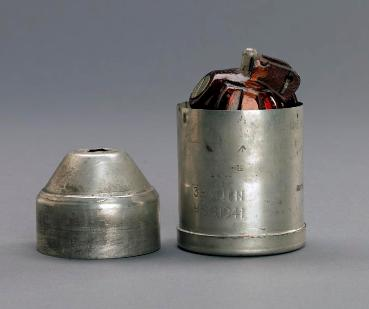The Holman Projector Grenade and container