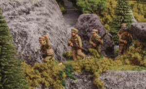 Chinese troops traverse a mountain