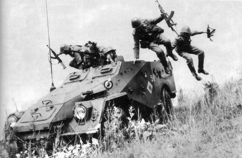 Troops dismount from a BTR-40